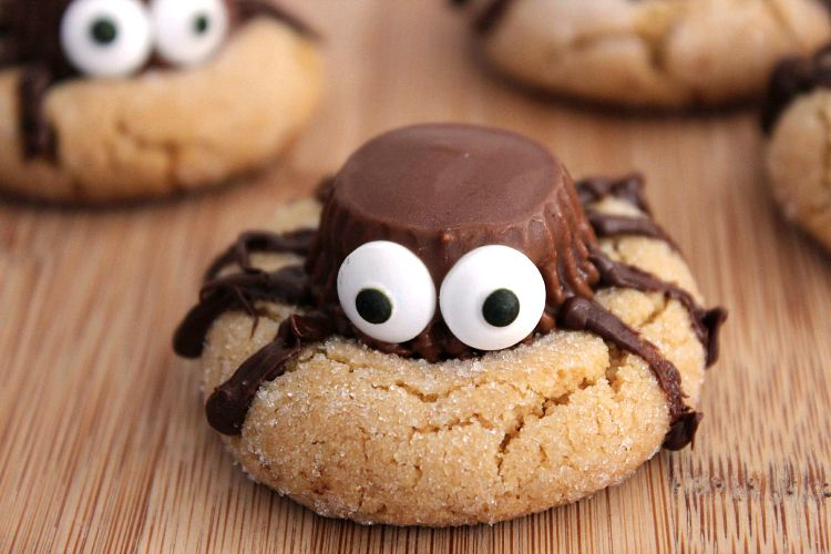 peanut butter cookie with reese's cup spider on top