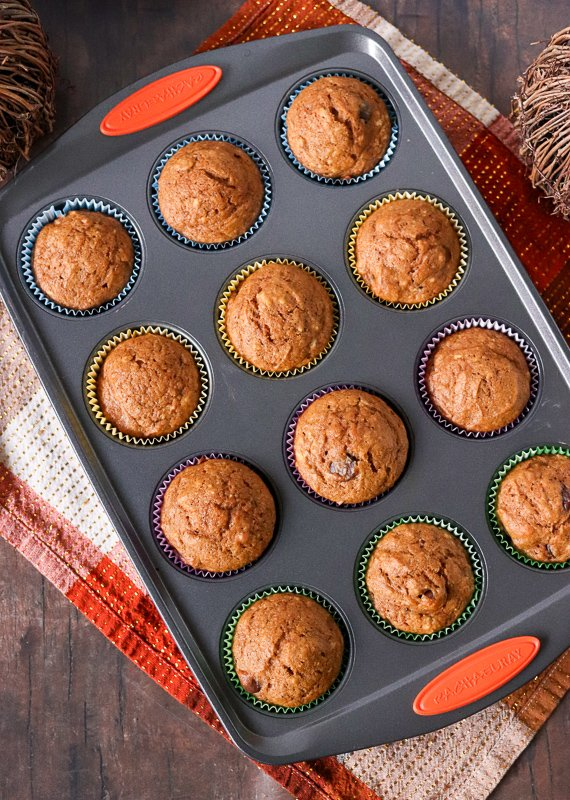 overhead shot of pumpkin muffins in muffin pan