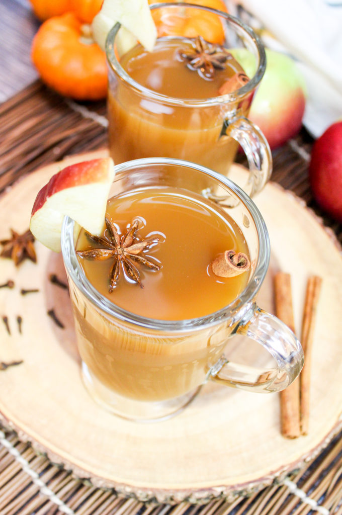 overhead shot of glass of slow cooker spiced apple cider