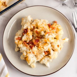white plate with serving of loaded cauliflower casserole