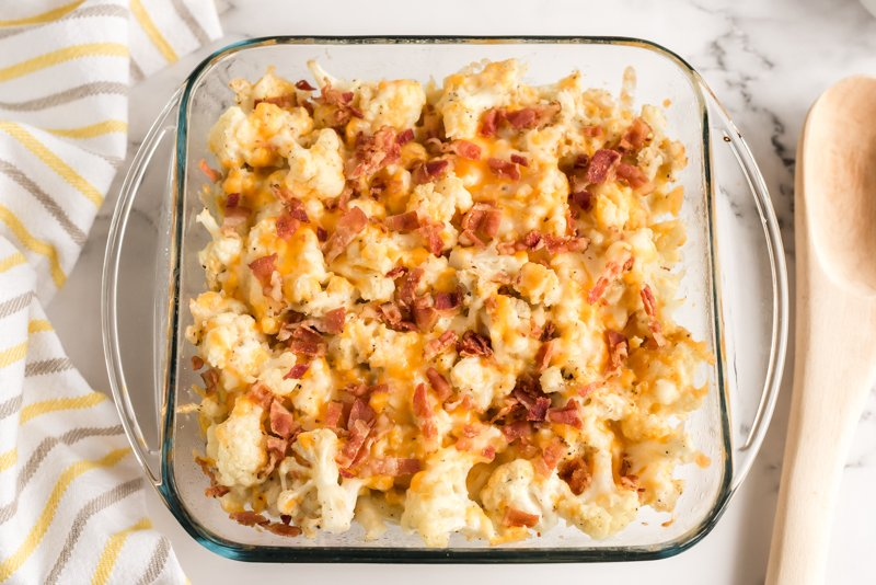 overhead shot of cauliflower casserole topped with bacon