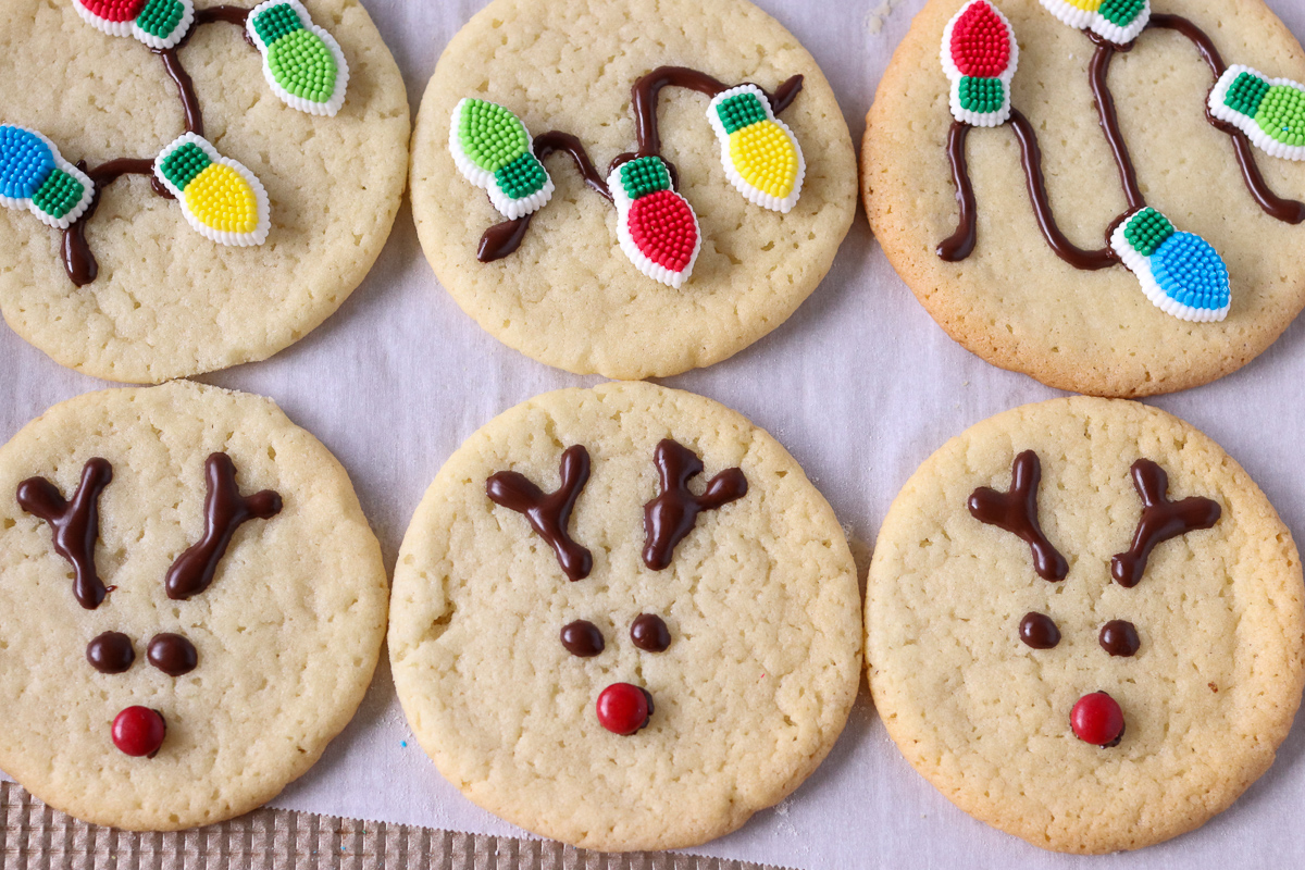 reindeer and christmas light cookies on a baking sheet