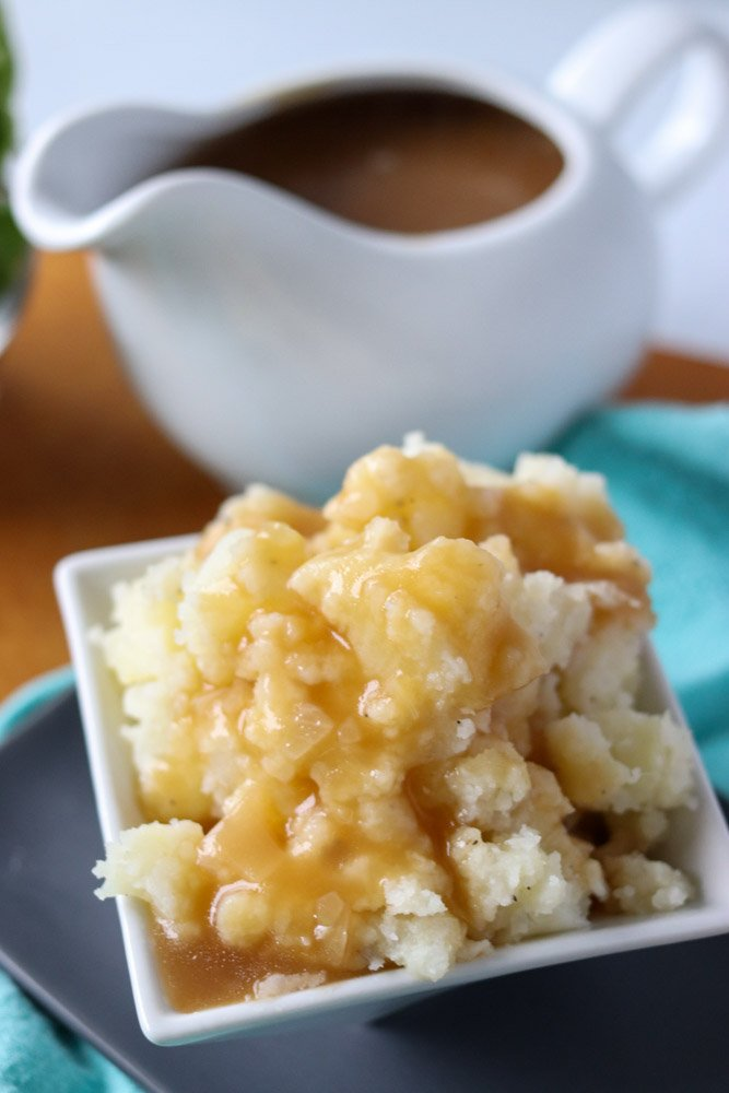 mashed potatoes & gravy in a white dish