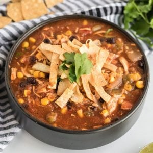 black bowl full of chicken tortilla soup
