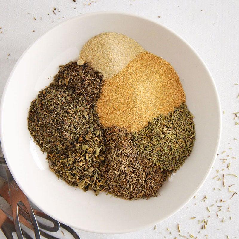 overhead shot of seasonings in white bowl