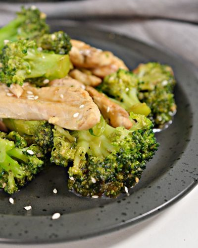 chinese chicken and broccoli on grey plate