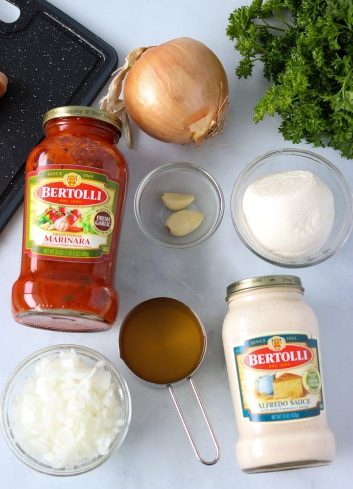 jars of bertolli pasta sauce laid out