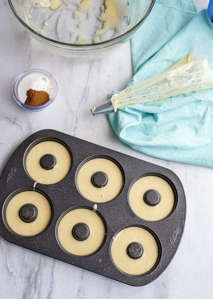 overhead shot of batter in donut baking pan