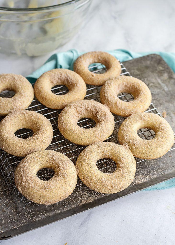 cinnamon sugar donuts on cooling rack