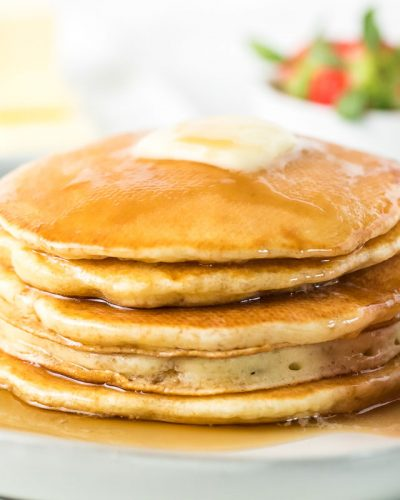 stack of pancakes covered in syrup