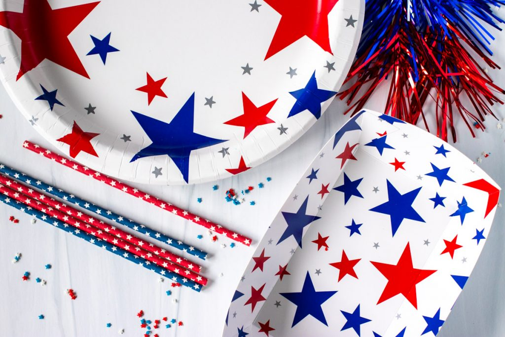 overhead shot of patriotic paper plates & party supplies