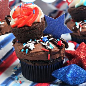 close up of chocolate cupcake with red white & blue sprinkles