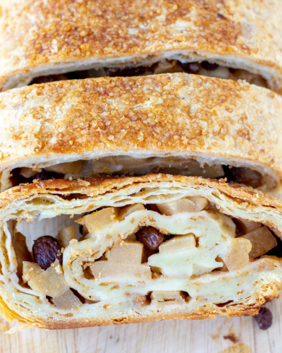 close up of two slices of apple strudel