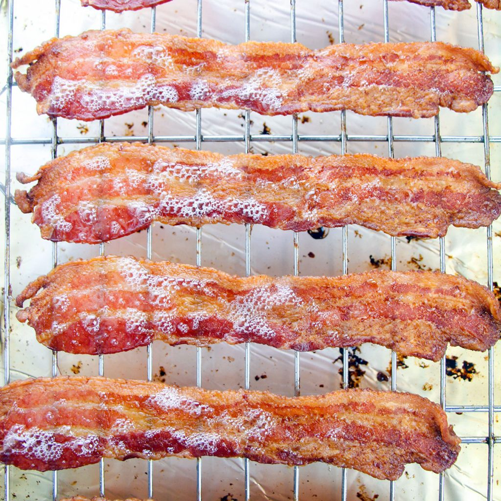 overhead shot of bacon on a cooling rack