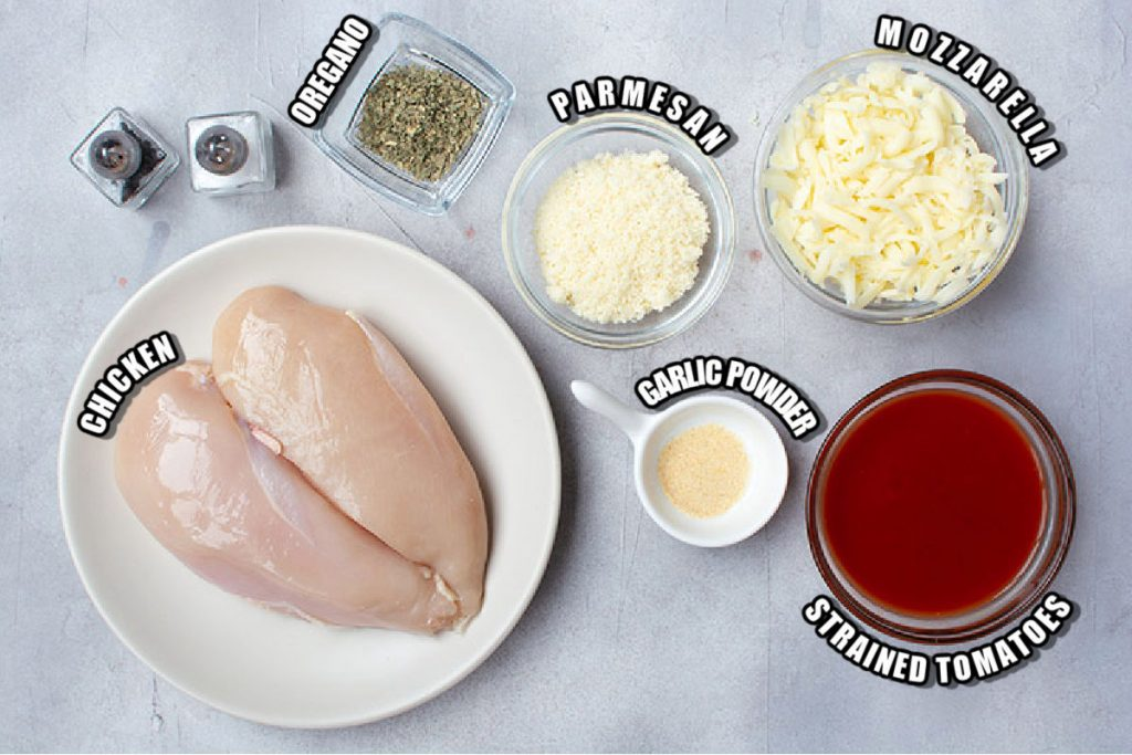 chicken, cheese, and ingredients laid out to make chicken parm