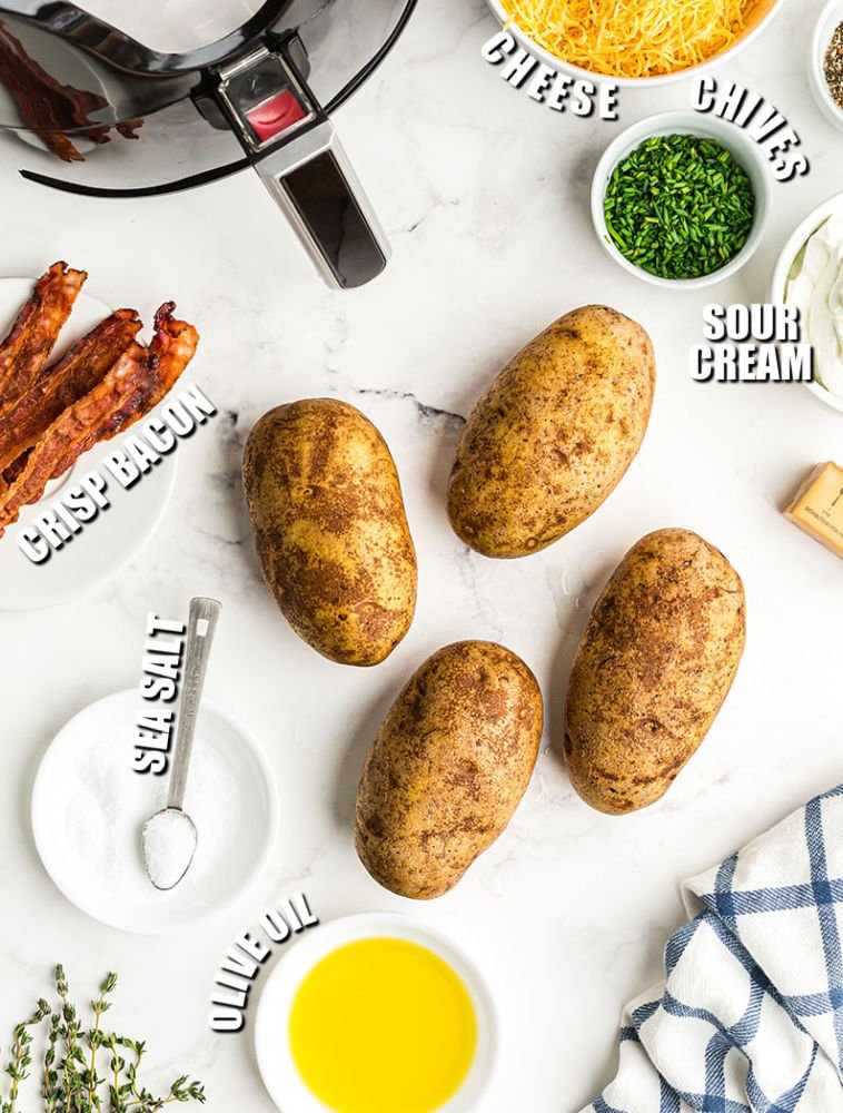 overhead shot of potatoes & ingredients to make loaded baked potatoes