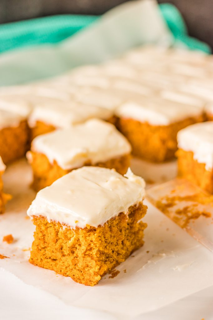 sliced pumpkin bars with thick cream cheese frosting