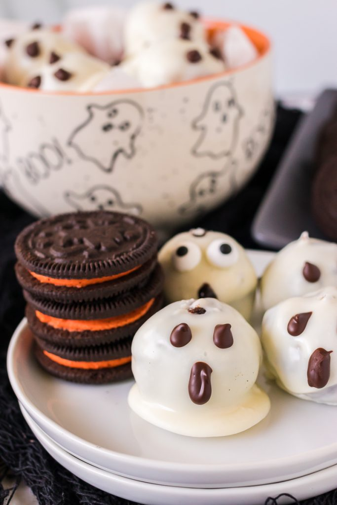 stack of halloween oreos next to oreo balls