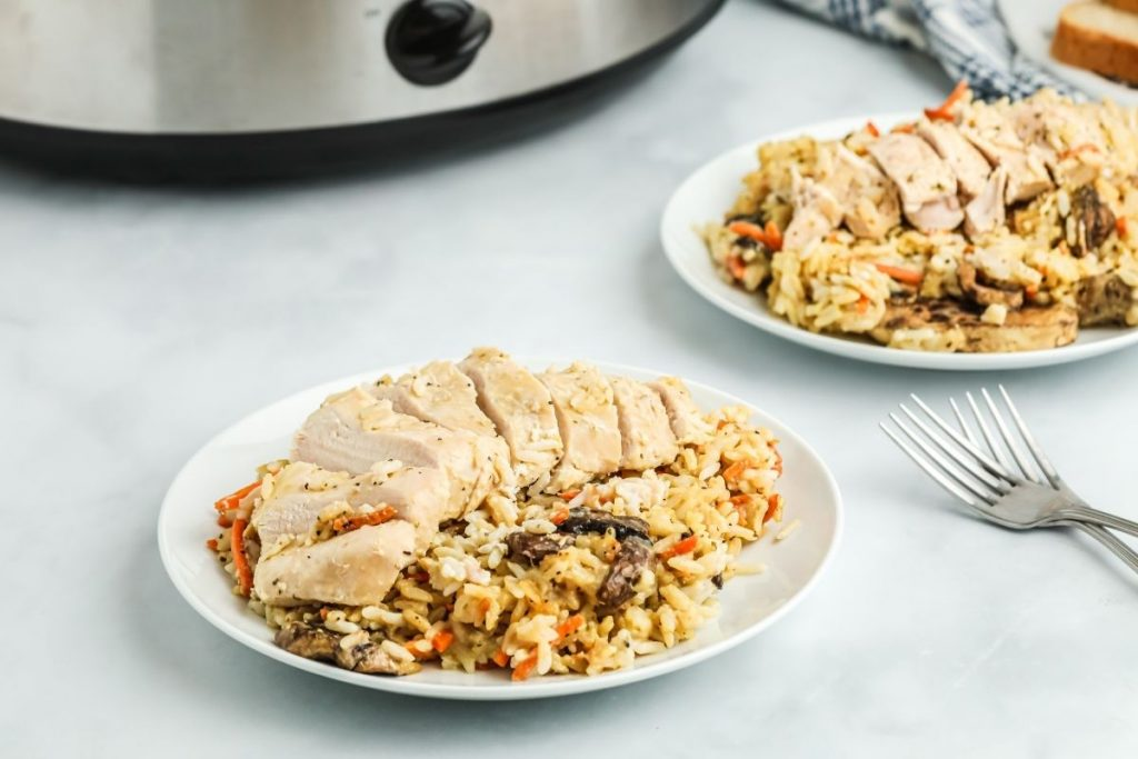 plated chicken and rice on a table
