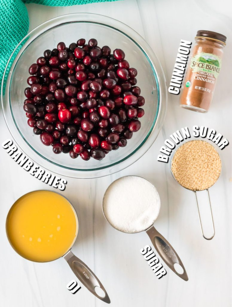 bowl of cranberries and ingredients to make sauce