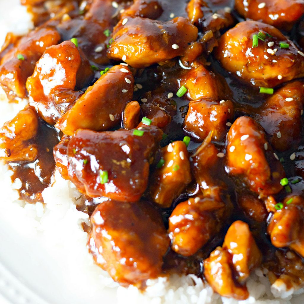 closeup of bourbon chicken over white rice