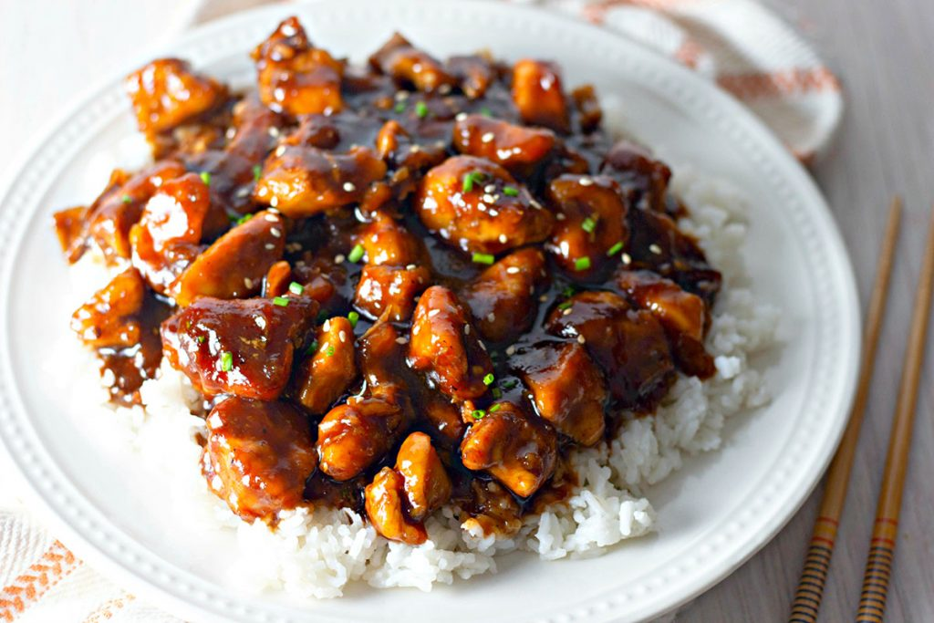 large plate of bourbon chicken over white rice