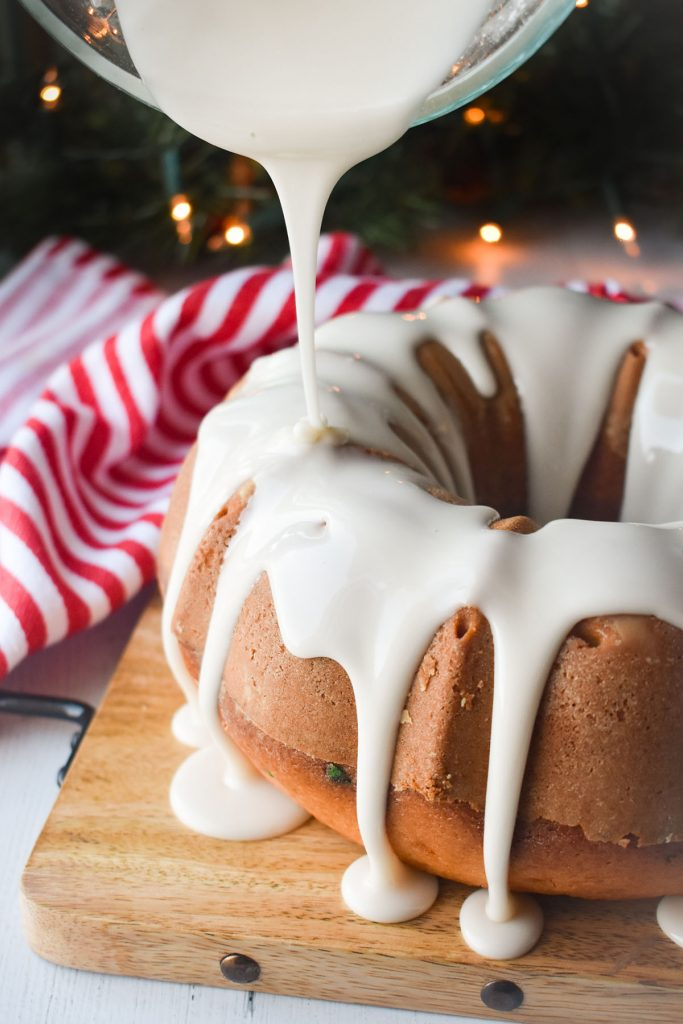 icing pouring over a bundt cake