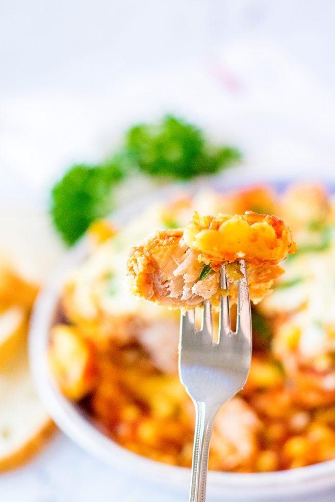 crockpot chicken parmesan up close on a fork