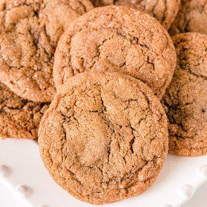 pile of molasses cookies on white platter