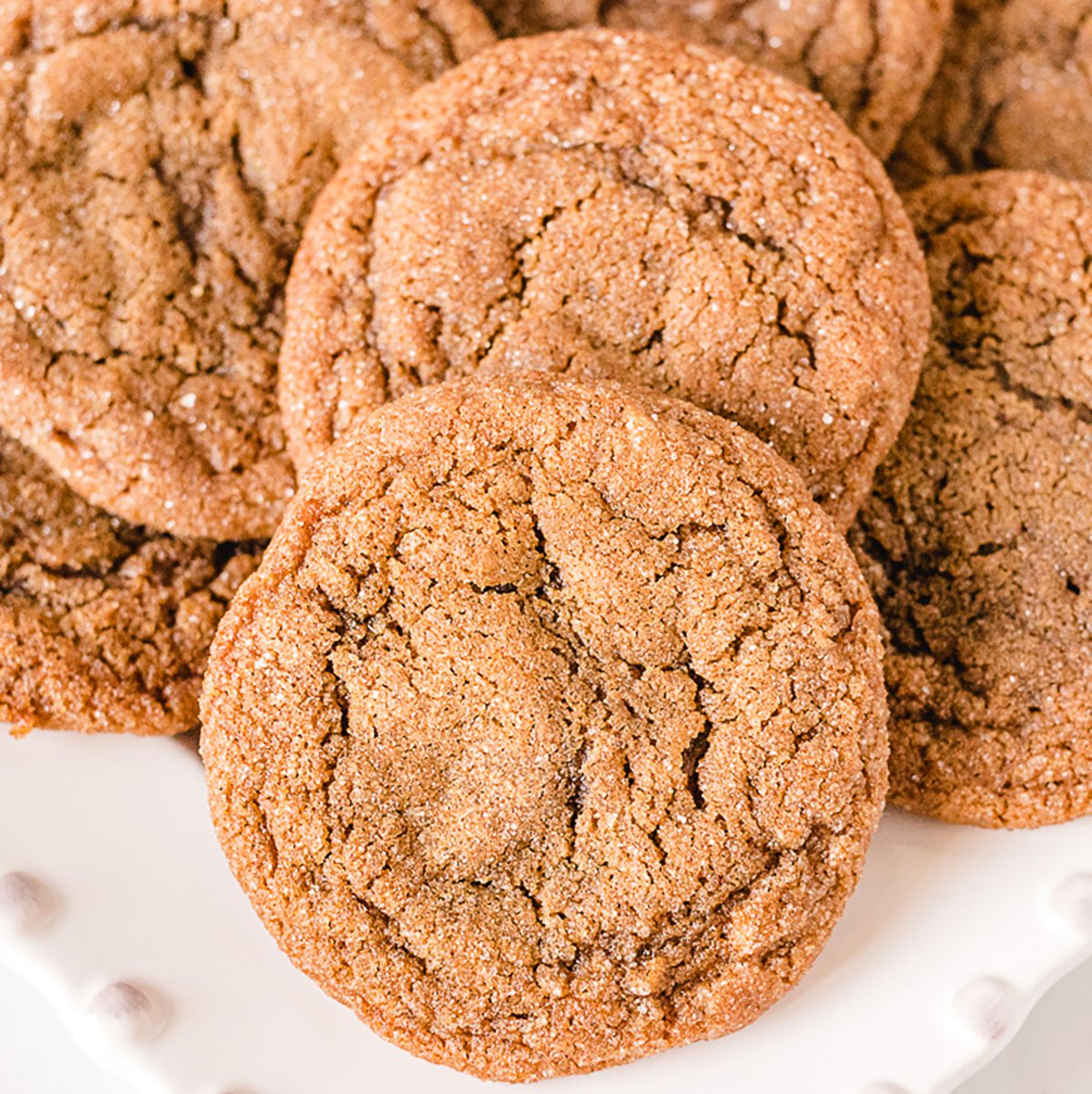 pile of molasses cookies on white platter