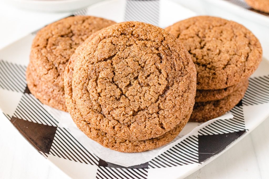 close up of molasses cookie on a buffalo plaid plate
