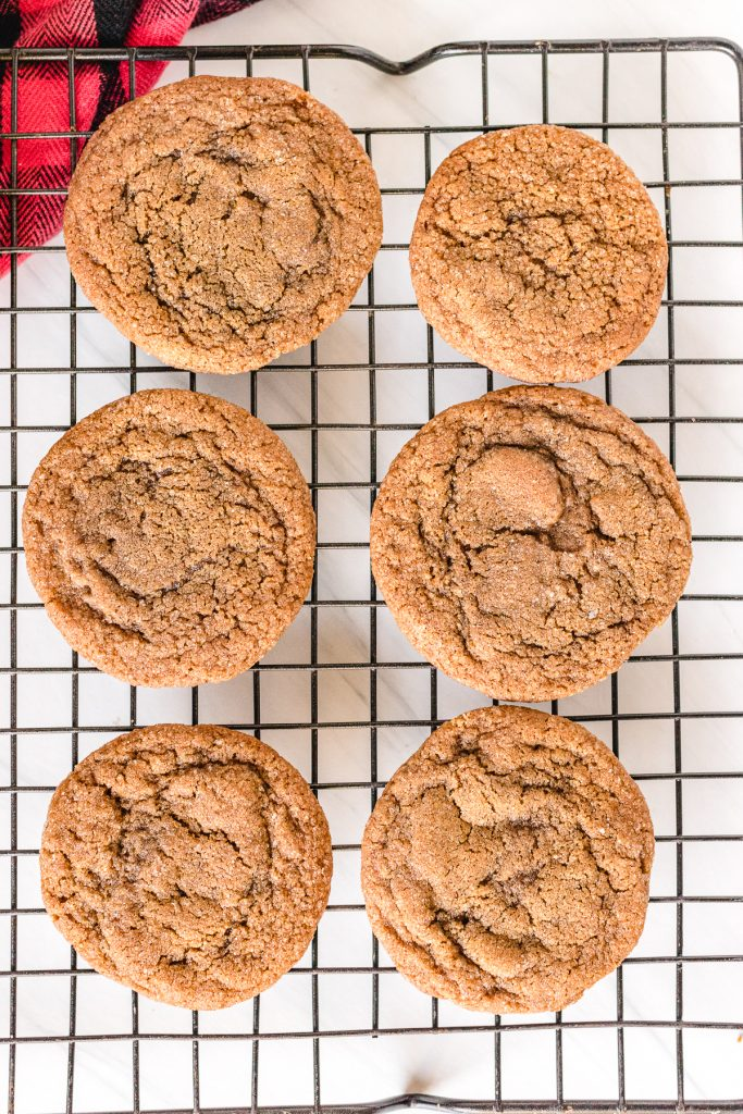 overhead shot of molasses cookies on a cooling rack