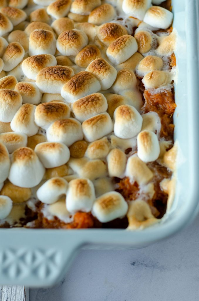 closeup of toasted marshmallows in baking dish