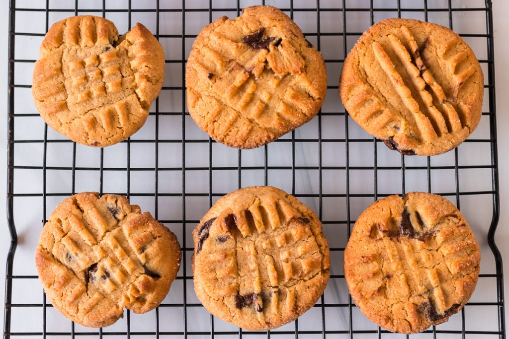 overhea shot of peanut butter chocolate chip cookies on a cooling rack