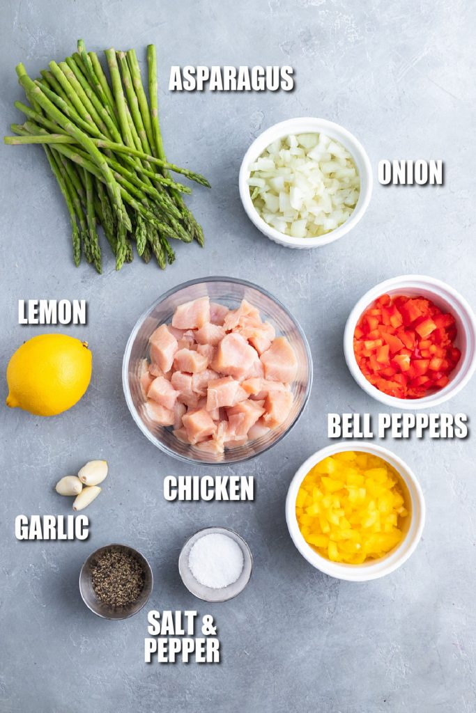 overhead shot of ingredients laid out to make spicy chicken pasta