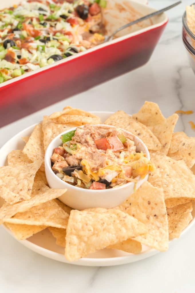 small bowl of easy taco dip surrounded by tortilla chips