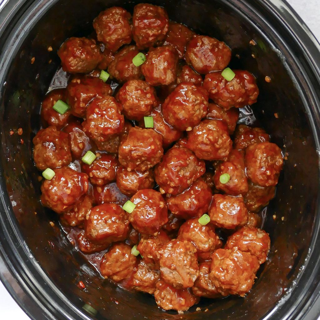 overhead shot of meatballs in a slow cooker