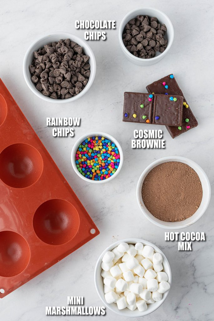 overhead shot of silicone mold and ingredients laid out to make hot cocoa bombs