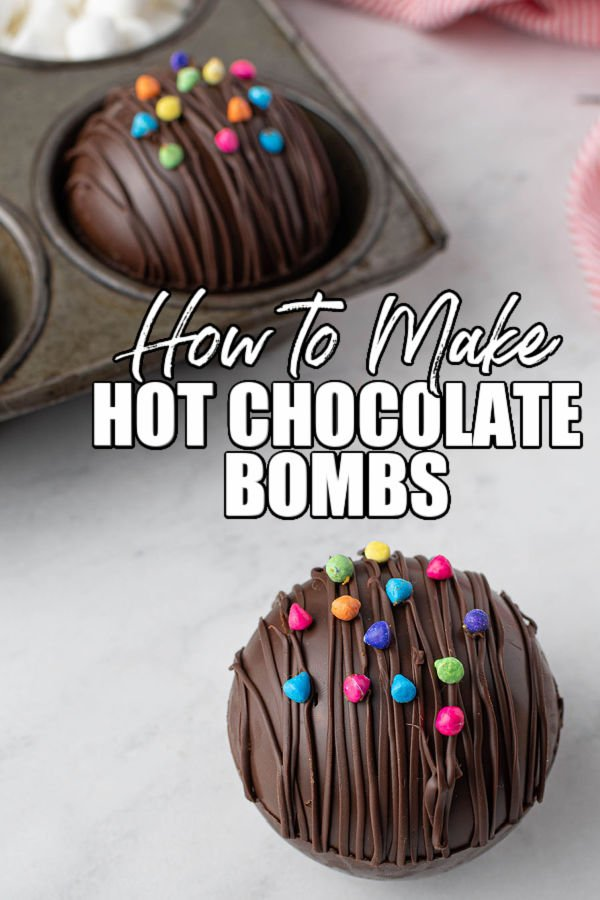 "hot cocoa bomb topped with rainbow chips with text reading ""how to make hot chocolate bombs"""