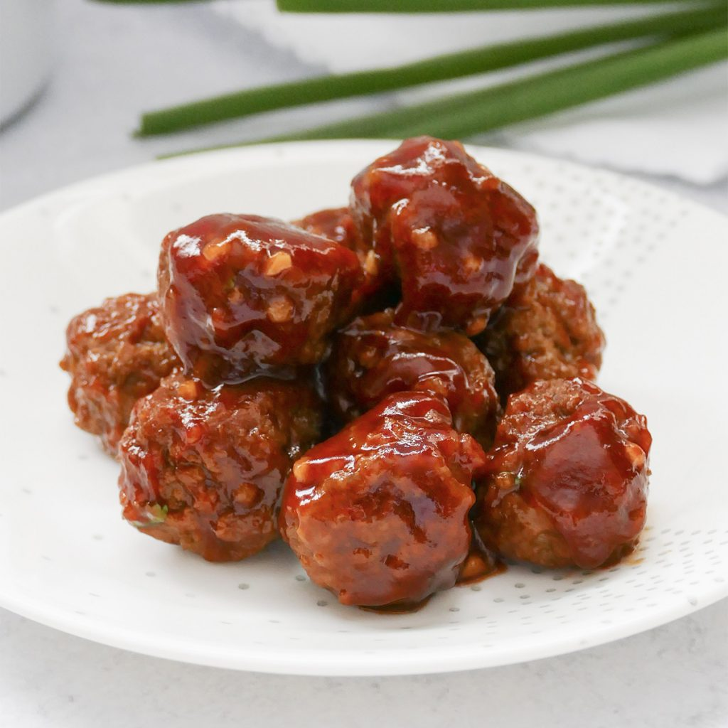 sweet & spicy slow cooker meatballs on a plate