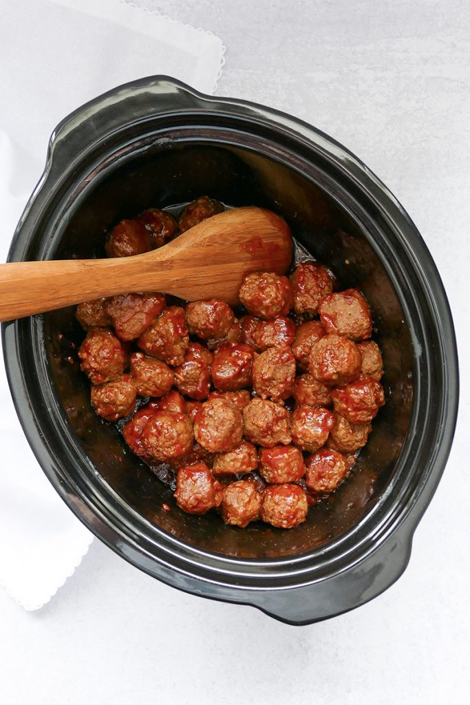 stirring sweet & spicy slow cooker meatballs