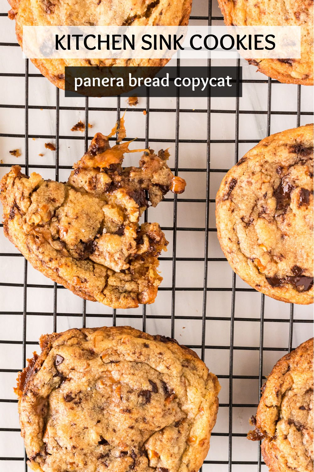 Filled with chocolate, caramel, and crushed pretzels, these Kitchen Sink Cookies are a Panera Bread copycat and the perfect blend of salty and sweet. One of these jumbo cookies is plenty to share, but you probably won't want to! | www.persnicketyplates.com