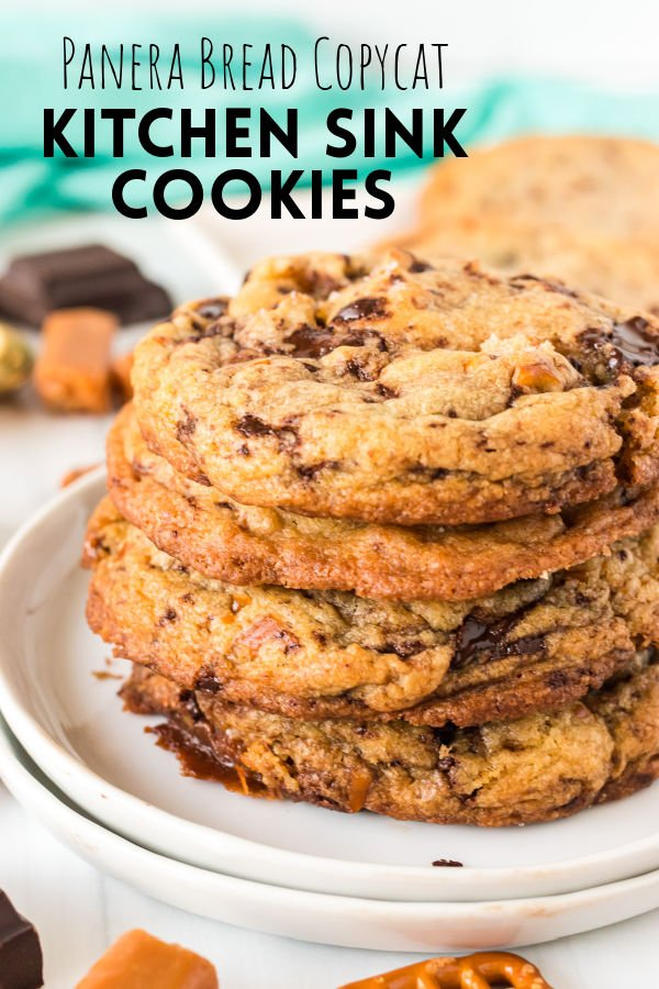 """stack cookies on a white plate with text overlay reading """"panera copycat kitchen sink cookies"""""""