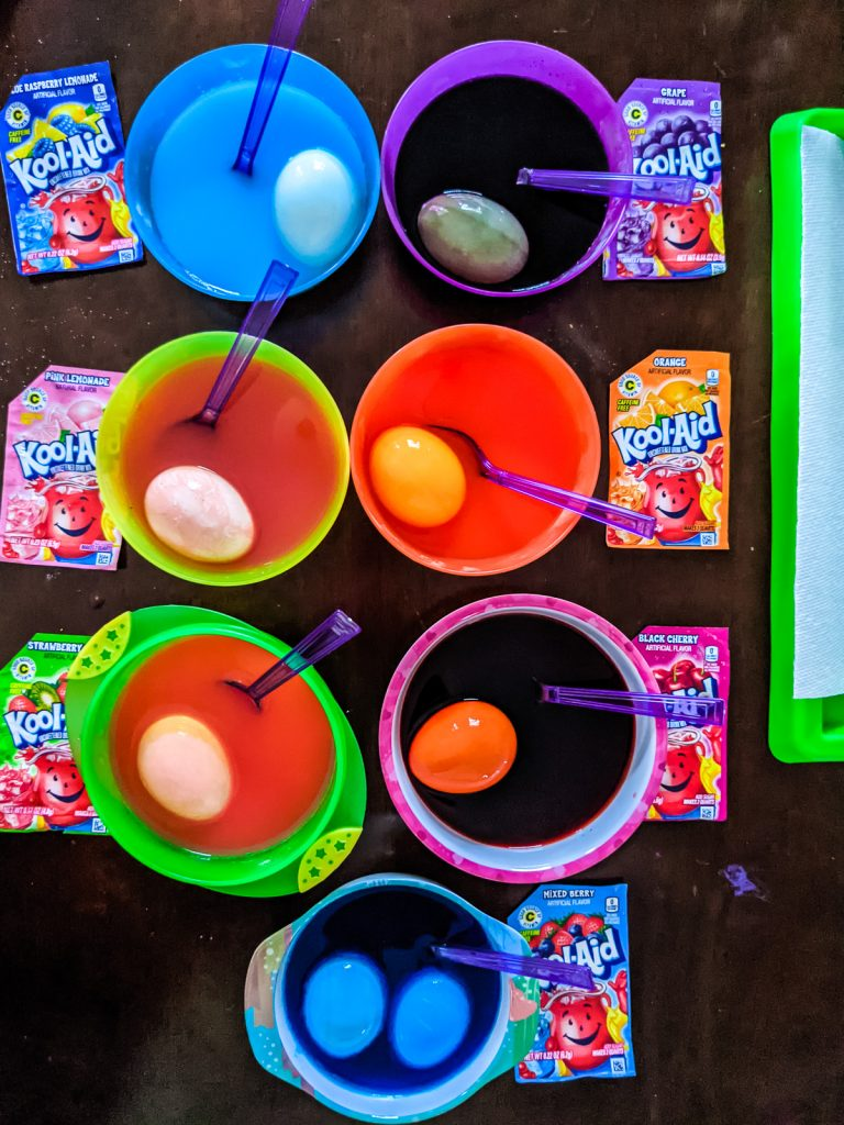 overhead shot of eggs in kool-aid to dye them