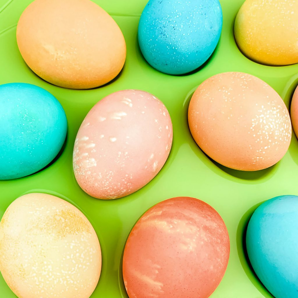 closeup of rainbow colored easter eggs