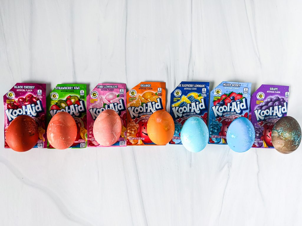 row of rainbow eggs with kool-aid packets