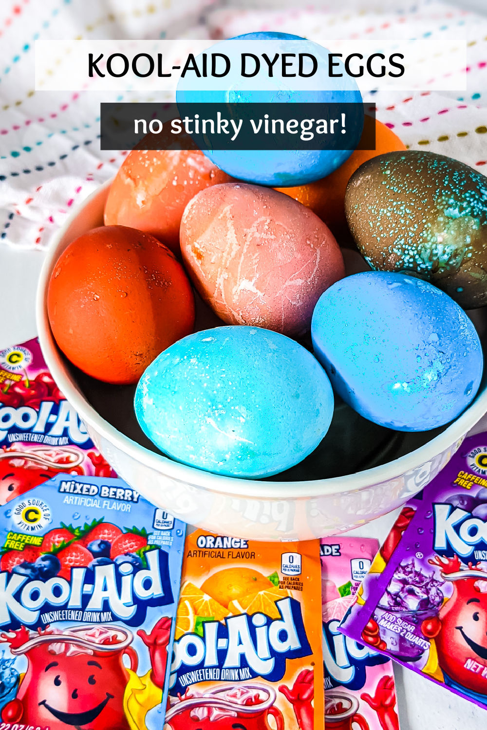 Want to try a new way to do your Easter egg coloring this year? Dyeing Easter eggs with Kool-Aid is different, fun, and smells great - no vinegar! | www.persnicketyplates.com