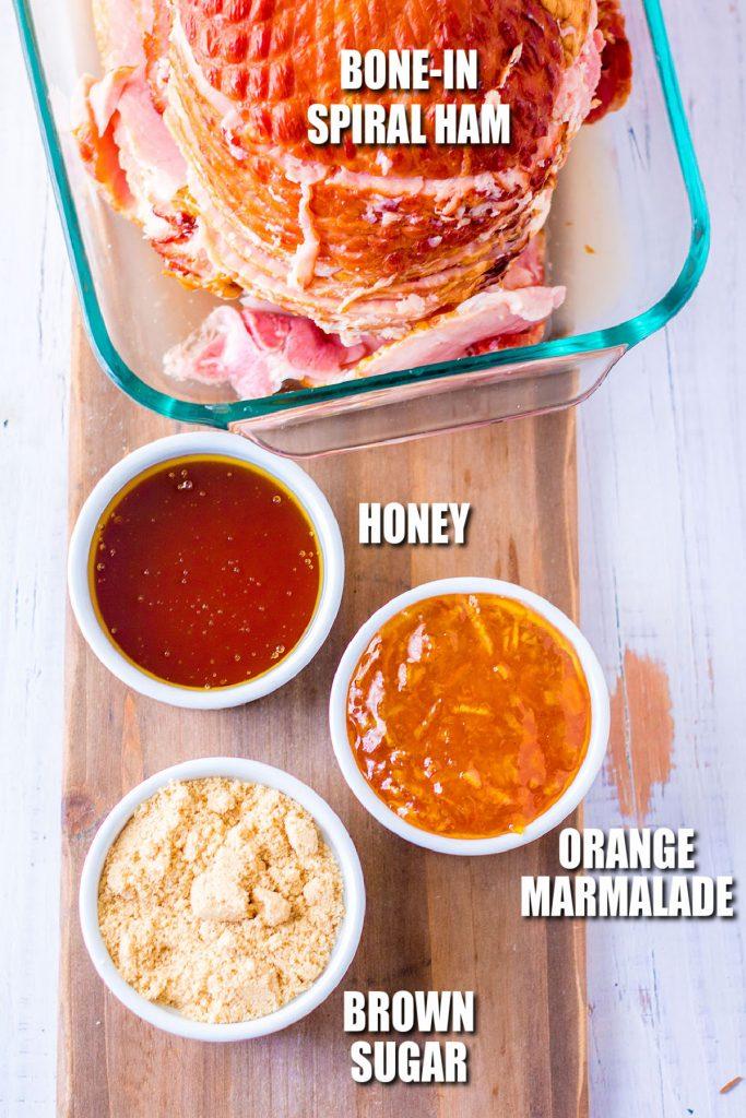 overhead shot of ham and ingredients to make orange honey glaze