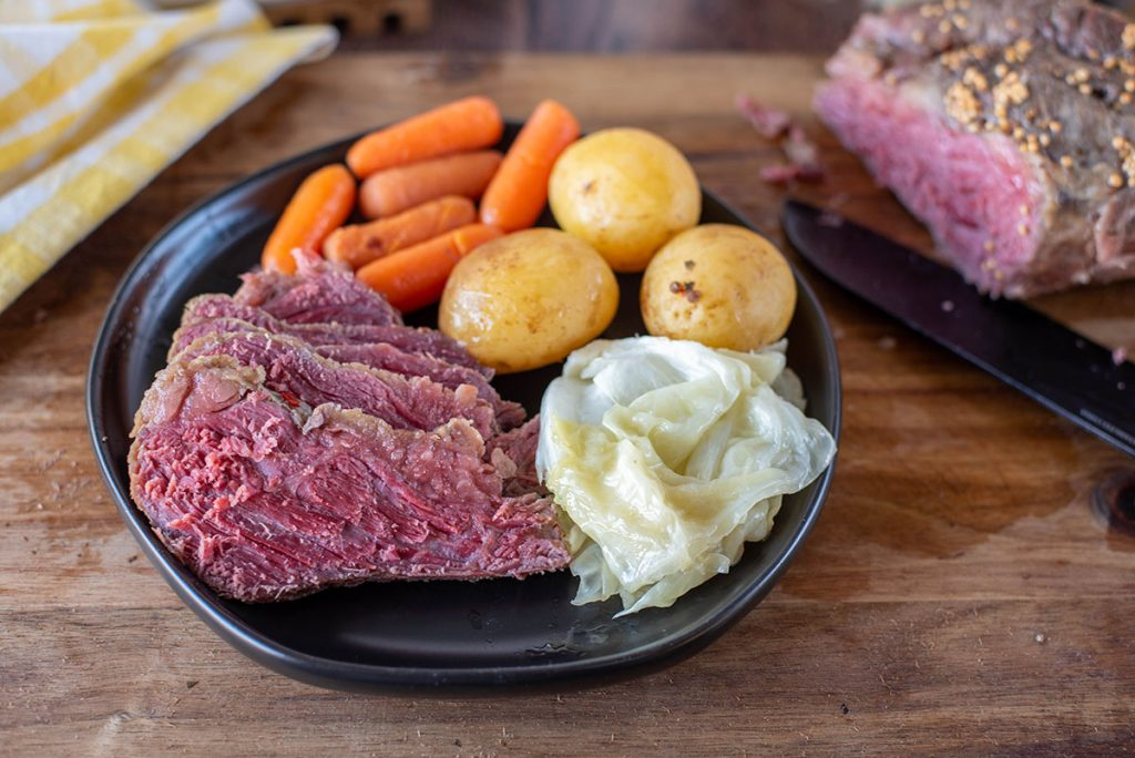 plate of corned beef, cabbage, potatoes, and carrots