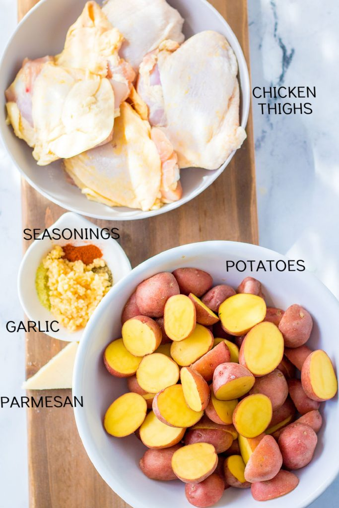 overhead shot of chicken, potatoes, and seasonings with text labels